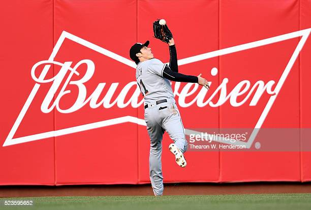 Christian Yelich of the Miami Marlins catches this fly ball off the bat of Brandon Belt of the San Francisco Giants in the bottom of the first inning...