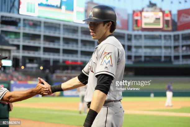 Christian Yelich of the Miami Marlins celebrates after scoring against the Texas Rangers in the sixth inning at Globe Life Park in Arlington on July...