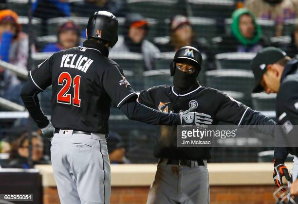 Christian Yelich of the Miami Marlins celebrates his third inning two run home run against the New York Mets with teammate Dee Gordon at Citi Field...