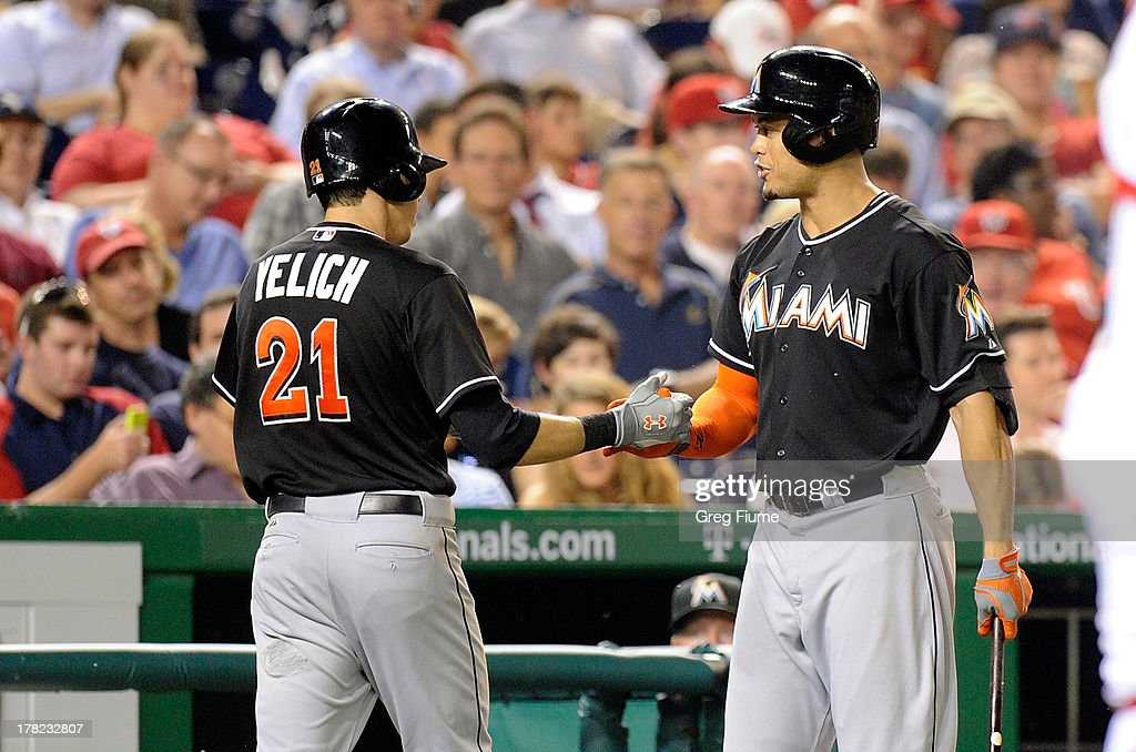 Christian Yelich #21 of the Miami Marlins celebrates with <a gi-track='captionPersonalityLinkClicked' href=/galleries/search?phrase=Giancarlo+Stanton&family=editorial&specificpeople=8983978 ng-click='$event.stopPropagation()'>Giancarlo Stanton</a> #27 after hitting a home run in the sixth inning against the Washington Nationals at Nationals Park on August 27, 2013 in Washington, DC.