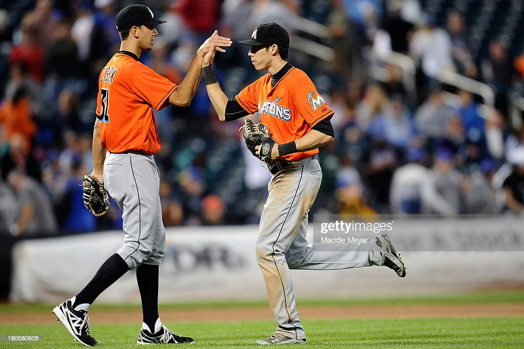 Christian Yelich #21 of the Miami Marlins celebrates with his teammate Steve Cishek #31 after the game against the New York Mets at Citi Field on September 14, 2013 in the Flushing neighborhood of the Queens borough of New York City. The Marlins defeated the Mets 3-0.