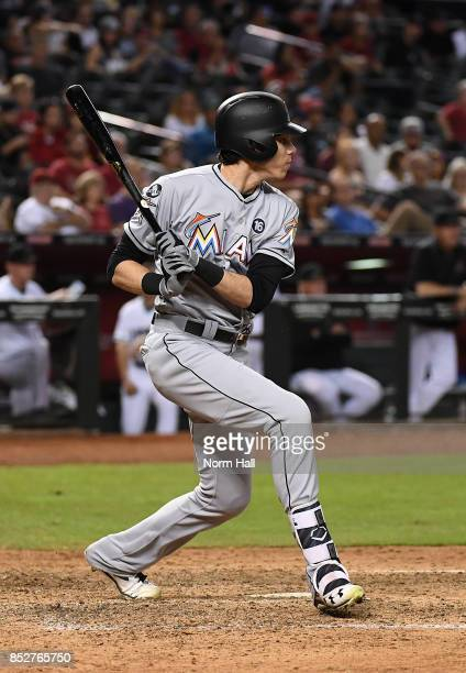 Christian Yelich of the Miami Marlins follows through on a swing against the Arizona Diamondbacks at Chase Field on September 22 2017 in Phoenix...