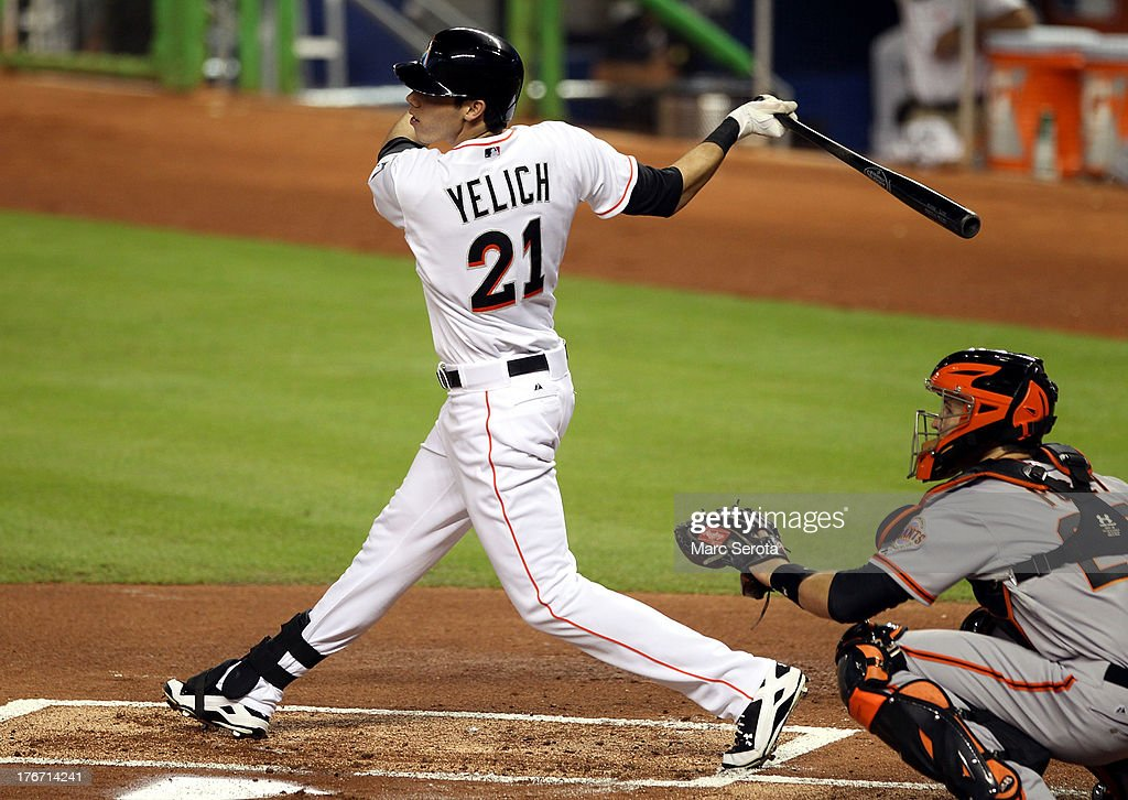Christian yelich #21 of the Miami Marlins gets a base hit against the San Francisco Giants during the fourth inning at Marlins Park on August 17, 2013 in Miami, Florida.