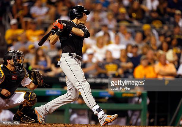 Christian Yelich of the Miami Marlins hits a RBI single in the eighth inning during the game against the Pittsburgh Pirates at PNC Park on August 19...