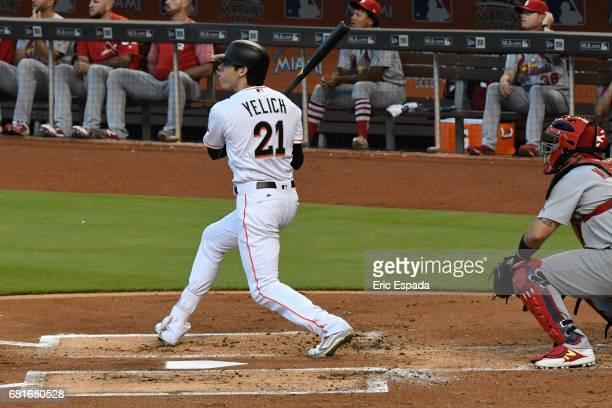 Christian Yelich of the Miami Marlins hits a solo home run in the first inning against the St Louis Cardinals at Marlins Park on May 10 2017 in Miami...