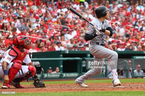 Christian Yelich of the Miami Marlins hits a threerun home run against the St Louis Cardinals in the sixth inning at Busch Stadium on July 4 2017 in...