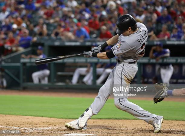 Christian Yelich of the Miami Marlins hits a threerun homerun against the Texas Rangers in the fifth inning at Globe Life Park in Arlington on July...