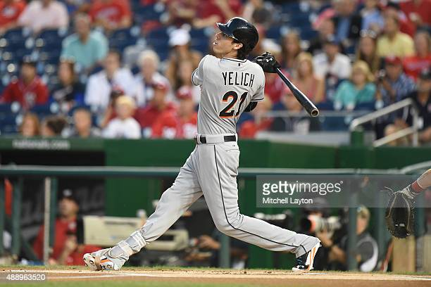 Christian Yelich of the Miami Marlins hits a two run home run first inning during a baseball game against the Washington Nationals at Nationals Park...