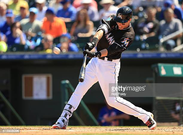 Christian Yelich of the Miami Marlins hits an RBI double during the spring training game against the New York Mets on March 15 2016 in Jupiter Florida