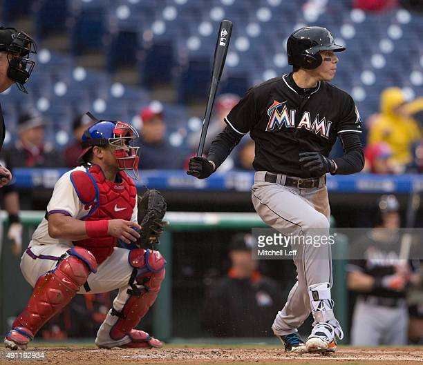 Christian Yelich of the Miami Marlins hits an RBI single in the top of the second inning against the Philadelphia Phillies on October 3 2015 at...