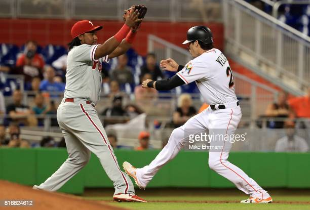 Christian Yelich of the Miami Marlins is tagged out in a rundown with Maikel Franco of the Philadelphia Phillies inning during a game at Marlins Park...