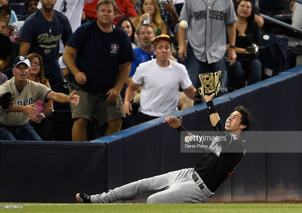 <a gi-track='captionPersonalityLinkClicked' href=/galleries/search?phrase=Christian+Yelich&family=editorial&specificpeople=9527291 ng-click='$event.stopPropagation()'>Christian Yelich</a> #21 of the Miami Marlins makes a sliding catch on a foul ball hit by Abraham Almonte #16 of the San Diego Padres during the third inning of a baseball game at Petco Park July 23, 2015 in San Diego, California.