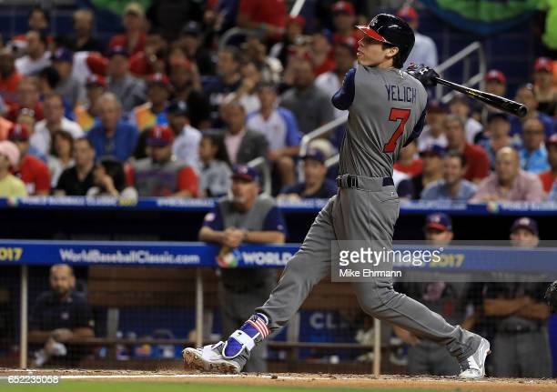 Christian Yelich the United States hits an RBI double during the second inning during a Pool C game of the 2017 World Baseball Classic against the...