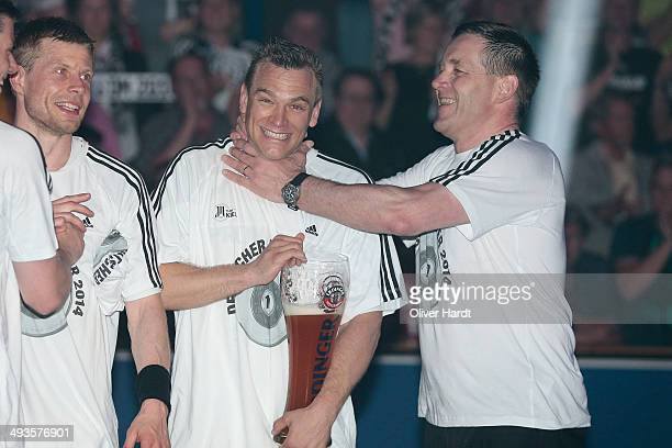 Christian Zeitz and Head coach Alfred Gislasonof Kiel celebrate after winning the DKB HBL Bundesliga match between THW Kiel and Fuechse Berlin on May...