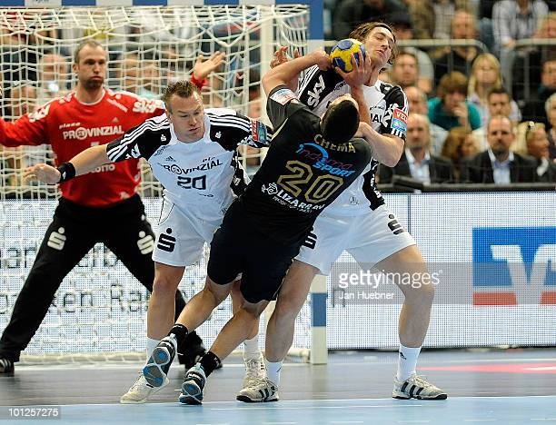 Christian Zeitz and Marcus Ahlm of THW Kiel defend against Chema Rodriguez of Ciudad Real during handball semi final match between Ciudad Real and...