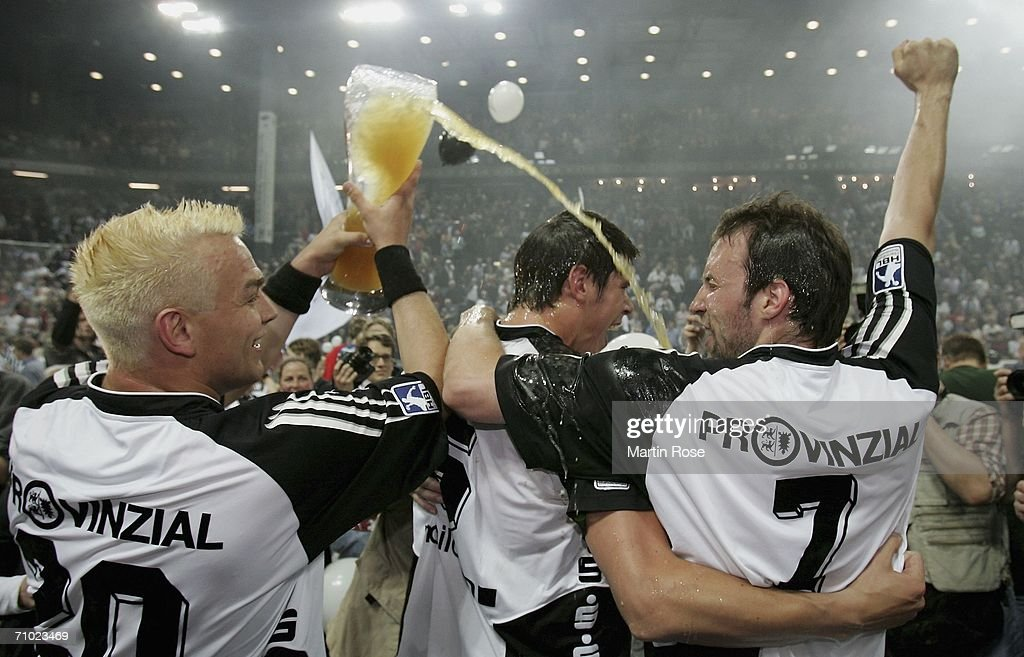 Christian Zeitz Kim Andersson and Vid Kavticnik of Kiel celebrate winning the Handball Bundesliga match between THW Kiel and TBV Lemgo at the Ostsee...