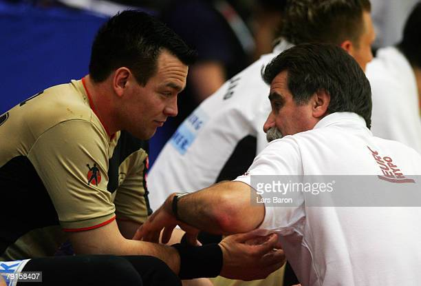 Christian Zeitz of Germany speaks with coach Heiner Brand during the Men's Handball European Championship main round Group II match between Germany...