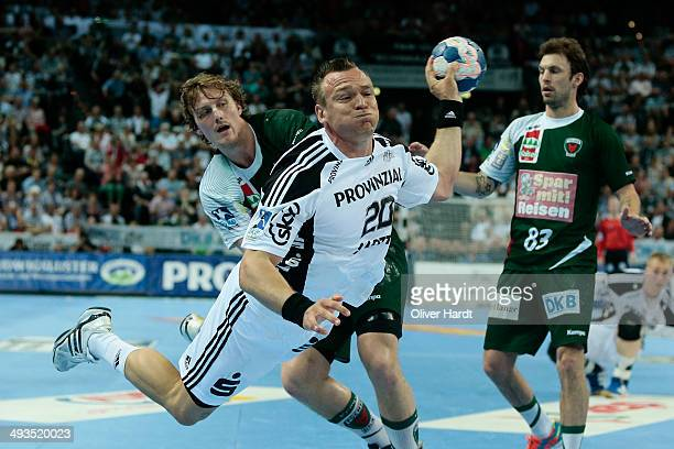 Christian Zeitz of Kiel challenges for the ball with Jesper Nielsen of Berlin during the DKB HBL Bundesliga match between THW Kiel and Fuechse Berlin...