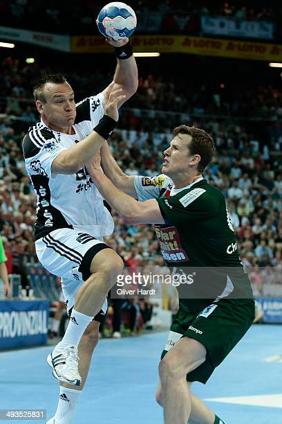 Christian Zeitz of Kiel challenges for the ball with Sven Soeren Christophersen of Berlin during the DKB HBL Bundesliga match between THW Kiel and...