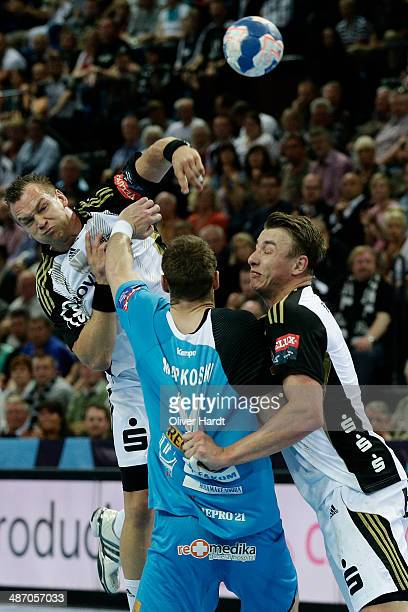 Christian Zeitz of Kiel challenges for the ball with Velko Markovski of Metalurg during the Velux EHF Champions League quarter final handball match...