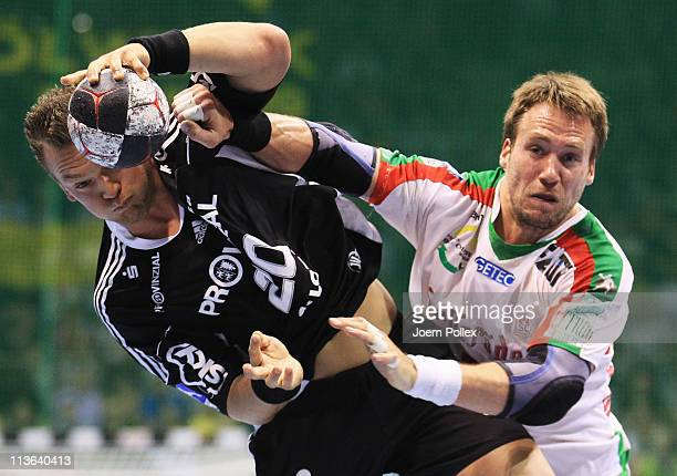 Christian Zeitz of Kiel is challenged by Kjell Landsberg of Magdeburg during the Toyota Handball Bundesliga match between SC Magdeburg and THW Kiel...