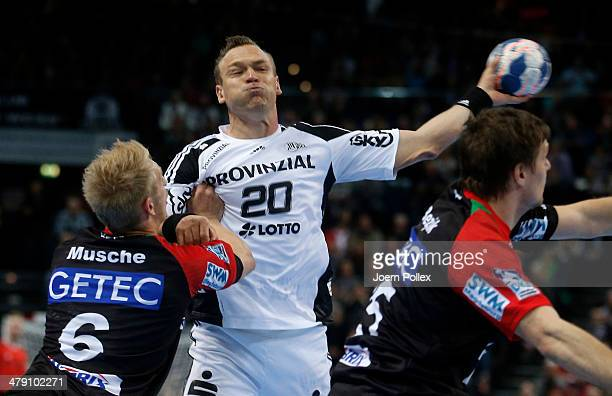 Christian Zeitz of Kiel is challenged by Matthias Musche of Magdeburg during the Bundesliga handball match between THW Kiel and SC Magdeburg at the...