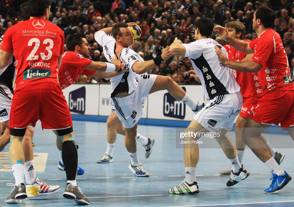 Christian Zeitz (3rd L) of Kiel is challenged by Nenad Vuckovic (2nd L) of Melsungen during the Toyota Handball Bundesliga match between THW Kiel and MT Melsungen at the Sparkassen Arena on February 23, 2011 in Kiel, Germany.