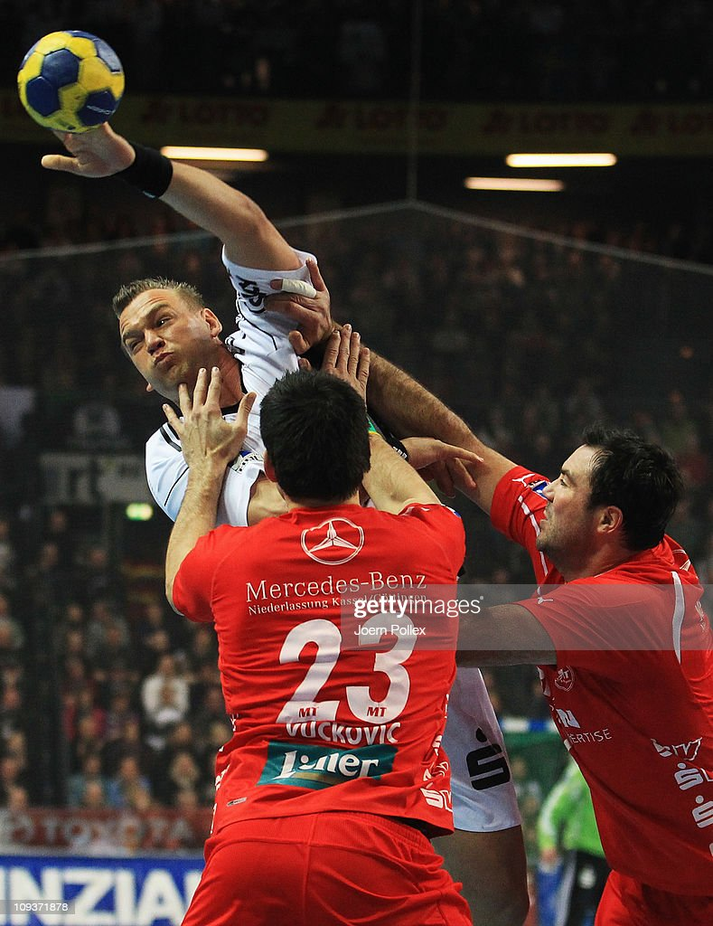Christian Zeitz (Top) of Kiel is challenged by Nenad Vuckovic of Melsungen during the Toyota Handball Bundesliga match between THW Kiel and MT Melsungen at the Sparkassen Arena on February 23, 2011 in Kiel, Germany.
