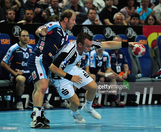 Christian Zeitz of Kiel is challenged byFrank Ettwein of Balingen during the Toyota Handball bundesliga match between THW Kiel and HBW...