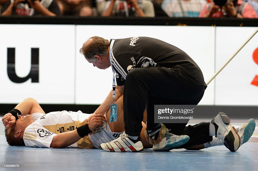 <a gi-track='captionPersonalityLinkClicked' href=/galleries/search?phrase=Christian+Zeitz&family=editorial&specificpeople=620399 ng-click='$event.stopPropagation()'>Christian Zeitz</a> of Kiel is treated during the EHF Final Four final match between THW Kiel and BM Atletico Madrid at Lanxess Arena on May 27, 2012 in Cologne, Germany.