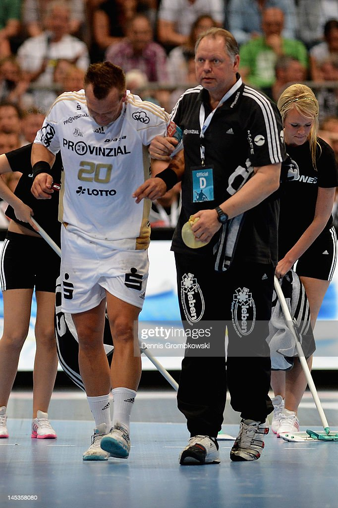 Christian Zeitz of Kiel is treated during the EHF Final Four final match between THW Kiel and BM Atletico Madrid at Lanxess Arena on May 27, 2012 in Cologne, Germany.