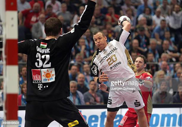 Christian Zeitz of Kiel throws the ball against goalkeeper Mirko Alilovic of Veszprem during the EHF Final Four match between MKB Veszprem KC and THW...