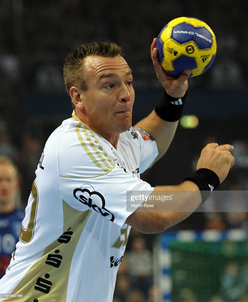 <a gi-track='captionPersonalityLinkClicked' href=/galleries/search?phrase=Christian+Zeitz&family=editorial&specificpeople=620399 ng-click='$event.stopPropagation()'>Christian Zeitz</a> of Kiel throws the ball during the EHF Champions League second leg match between THW Kiel and Orlen Wisla Plock at Sparkassen Arena on March 18, 2012 in Kiel, Germany.