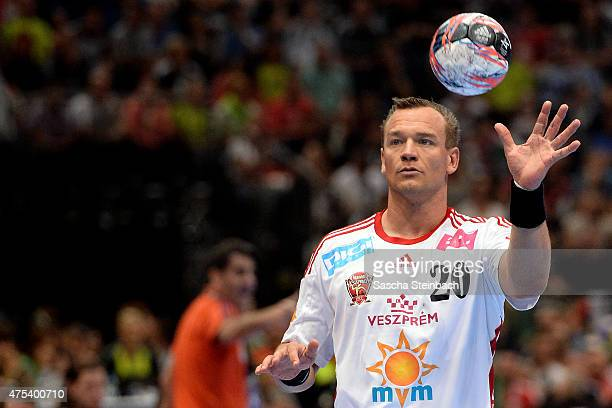 Christian Zeitz of Veszprem controls the ball during the 'VELUX EHF FINAL4' final match between FC Barcelona and MKBMVM Veszprem at Lanxess Arena on...