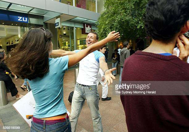 Christiana Christodoulou hugs a stranger in Pitt Street Mall this afternoon on 4 November 2004 SMH NEWS Picture by WADE LAUBE
