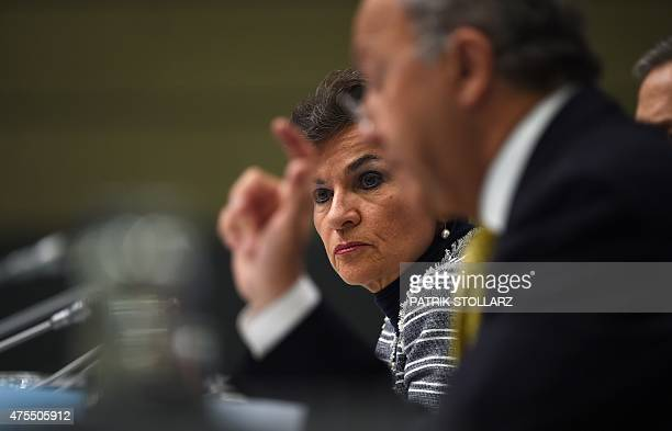 Christiana Figueres Executive Secretary of the United Nations Framework Convention on Climate Change listens as French Foreign Minister Laurent...