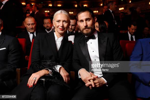 Christiane Arp and Clemens Schick attend the GQ Men of the year Award 2017 at Komische Oper on November 9 2017 in Berlin Germany