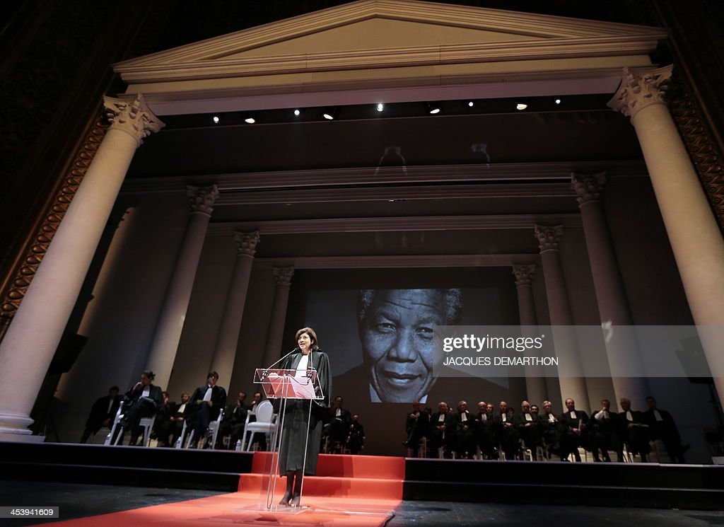 Christiane Feral-Schuhl, president of the Paris Bar, speaks to pay tribute to late South African President Nelson Mandela (seen on screen) during a solemn session of the return of the Paris bar association on December 6, 2013 at the Theatre du Chatelet in Paris. Mandela, the revered icon of the anti-apartheid struggle in South Africa and one of the towering political figures of the 20th century, has died on December 5 aged 95. Mandela, who was elected South Africa's first black president after spending nearly three decades in prison, had been receiving treatment for a lung infection at his Johannesburg home since September, after three months in hospital in a critical state.