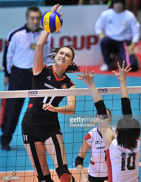 Christiane Fürst of Germany spikes the ball over Nana Iwasaka of Japan during a match of the World Cup women's volleyball tournament in Tokyo on...