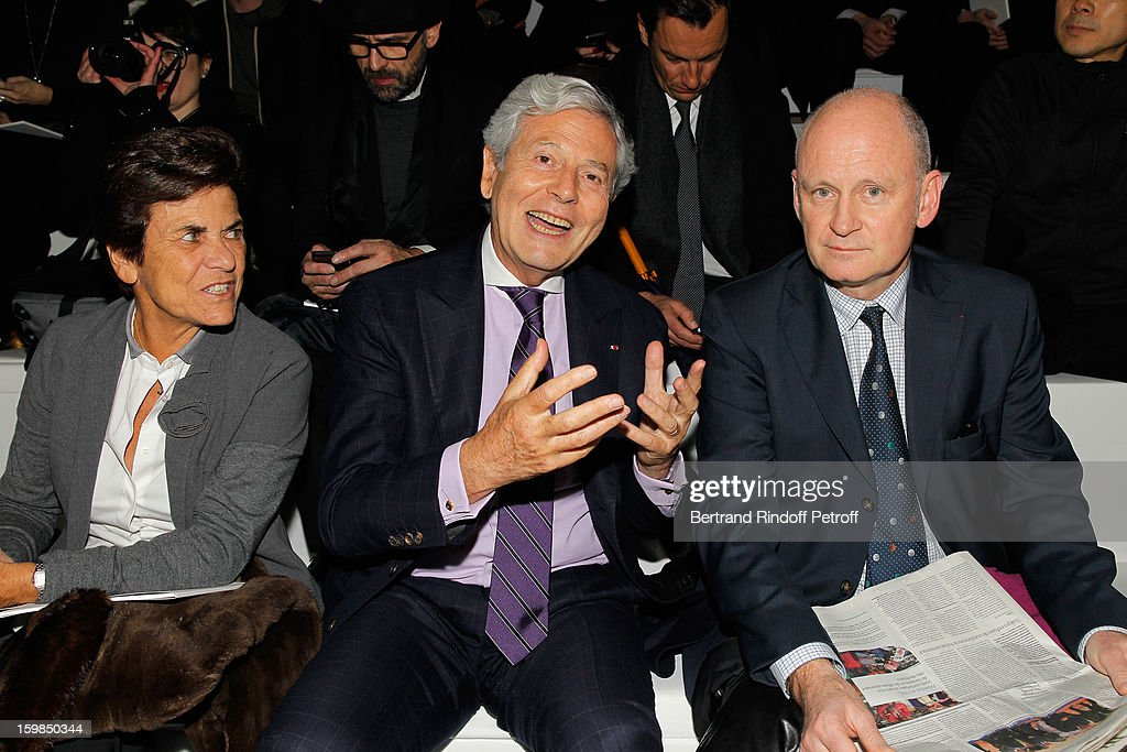 Christiane Houze, her husband Philippe Houze, CEO of Galeries Lafayette, and Christophe Girard attend the Christian Dior Spring/Summer 2013 Haute-Couture show as part of Paris Fashion Week at on January 21, 2013 in Paris, France.