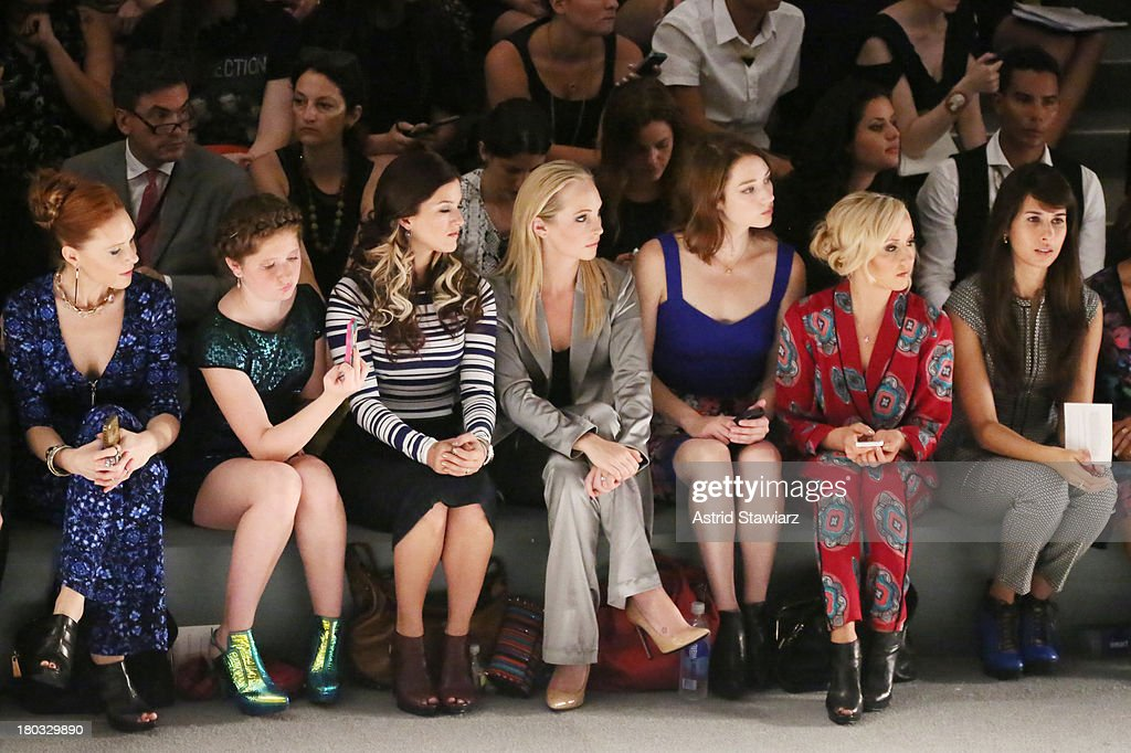 Christiane Seidel, Emma Kenney, <a gi-track='captionPersonalityLinkClicked' href=/galleries/search?phrase=Cassadee+Pope&family=editorial&specificpeople=5613333 ng-click='$event.stopPropagation()'>Cassadee Pope</a>, <a gi-track='captionPersonalityLinkClicked' href=/galleries/search?phrase=Candice+Accola&family=editorial&specificpeople=2335285 ng-click='$event.stopPropagation()'>Candice Accola</a>, guest, <a gi-track='captionPersonalityLinkClicked' href=/galleries/search?phrase=Nastia+Liukin&family=editorial&specificpeople=241334 ng-click='$event.stopPropagation()'>Nastia Liukin</a> and Zineb Oukash sit front row with TRESemme at the Nanette Lepore fashion show during Mercedes-Benz Fashion Week Spring 2014 at The Stage at Lincoln Center on September 11, 2013 in New York City.