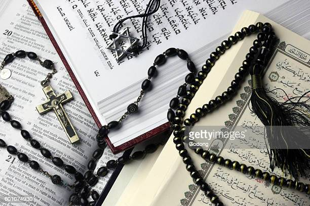 3 monotheistic religions Bible Quran and Bible Interfaith symbols France
