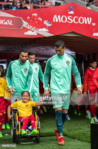 Christiano Ronaldo of Portuga walks with a McDonalds mascot girl in a wheel chair on the pitch prior to the FIFA Confederations Cup Russia 2017 Group...