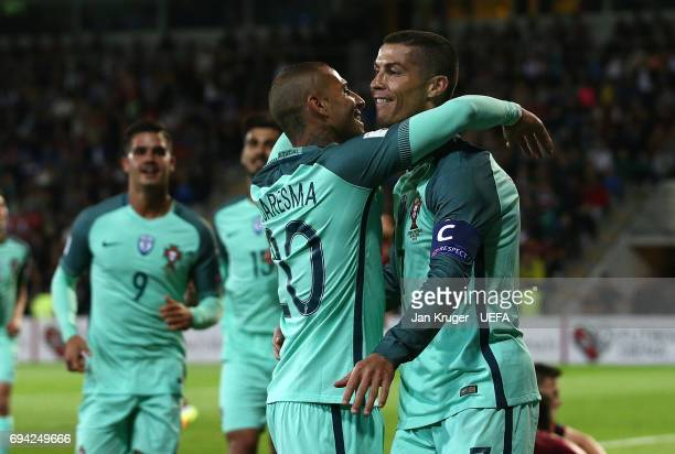 Christiano Ronaldo of Portugal celebrates his second goal with team mates during the FIFA 2018 World Cup Qualifier between Latvia and Portugal at...