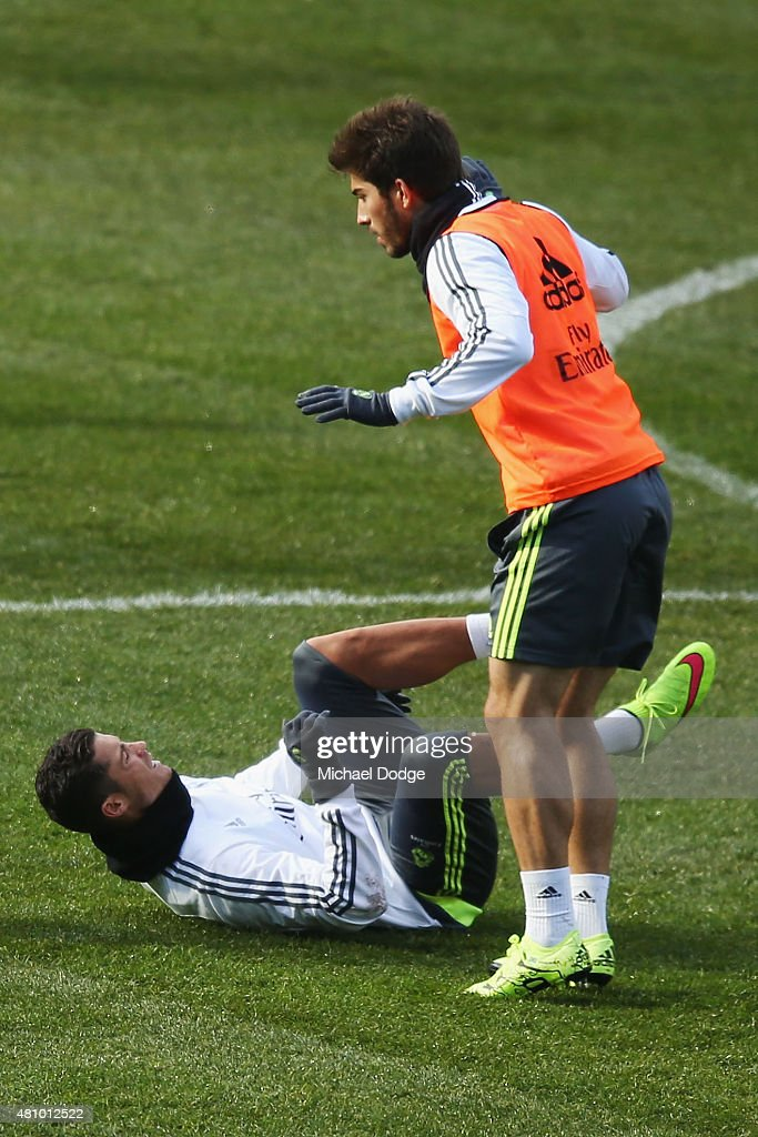 Christiano Ronaldo of Real Madrid reacts after going to ground in a contest with Sergio Ramos of Real Madrid during a Real Madrid training session at Melbourne Cricket Ground on July 17, 2015 in Melbourne, Australia.