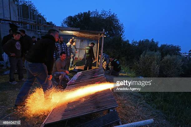 Christians ignite homemade rockets at 'Rocket War' during Greek Orthodox Easter celebrations in the town of Vrontados on the Greek island of Chios on...