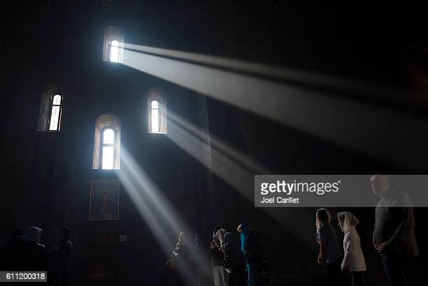Christians inside Tatev Monastery in Armenia