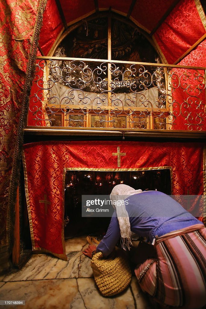 Christians pray at the altar in the Grotto of the church of the Nativity, the spot believed to be the birth place of Jesus Christ on June 16, 2013 in Bethlehem, West Bank.
