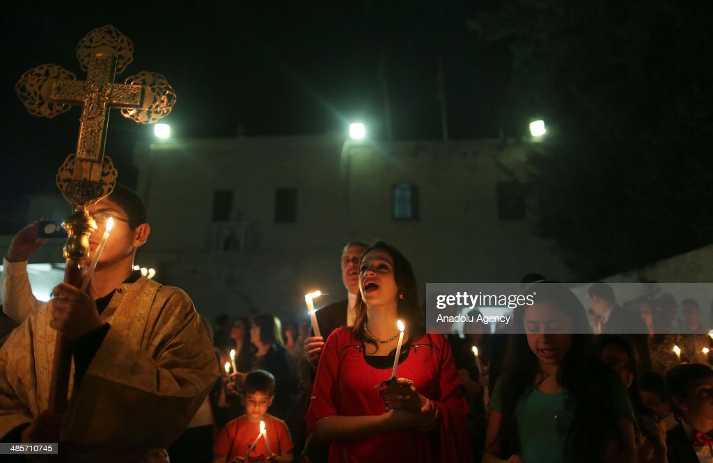 Christians pray during the Easter Celebration ceremony in Saint Porphyrius Orthodox Christian church of Gaza on April 19, 2014.