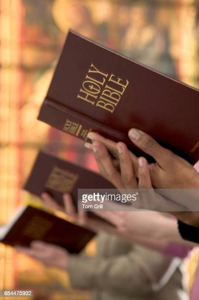 Christians Reading Bibles in Church